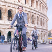 Rome City E-Bike in from of the Colosseum
