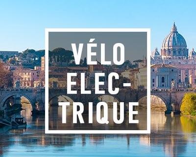 Vue sur le Tibre et la basilique Saint Pierre lors de nos visites à vélos électriques